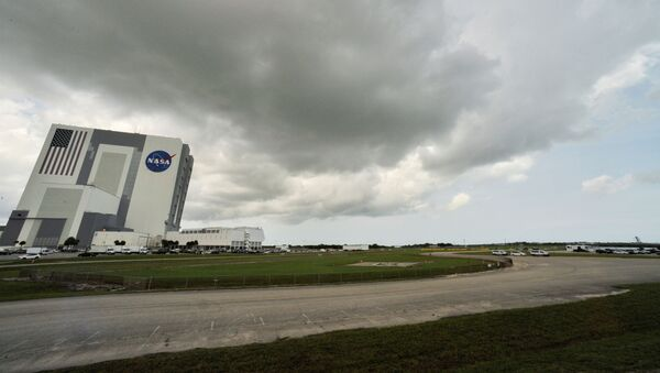 Weather over Cape Canaveral as SpaceX Falcon 9 rocket and Crew Dragon spacecraft carrying NASA astronauts Douglas Hurley and Robert Behnken waits to lift-off for NASA's SpaceX Demo-2 mission to the International Space Station from NASA's Kennedy Space Center in Cape Canaveral, Florida, U.S.  May 30, 2020. - Sputnik International
