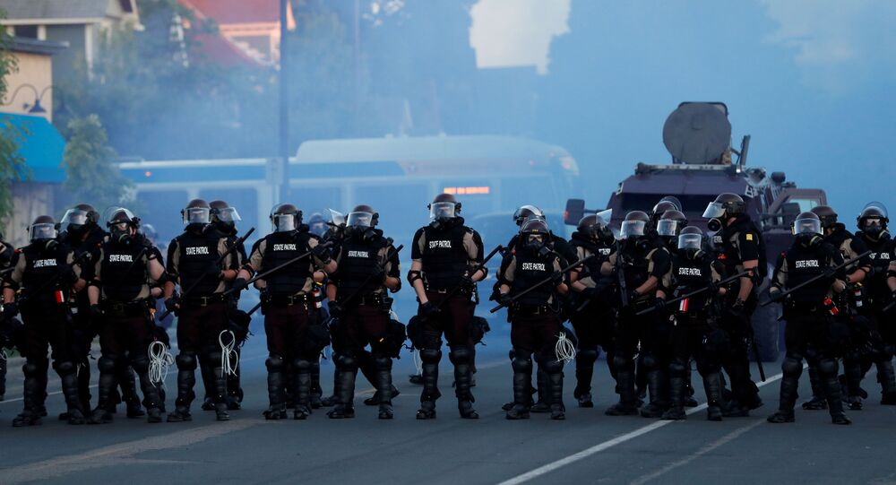 Security forces take position during a protest against the death in Minneapolis police custody of George Floyd, in Minneapolis, Minnesota, U.S., May 30, 2020