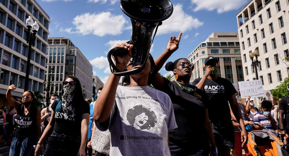 Protesters march against the death in Minneapolis police custody of George Floyd, near the White House in Washington, U.S., June 7, 2020.