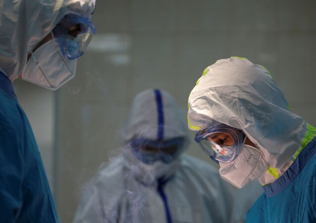 Doctor Islam Muradov (L) performs emergency surgery in the operating room of the City Clinical Hospital Number 15 named after O. Filatov, which delivers treatment to patients infected with the coronavirus disease (COVID-19), in Moscow, Russia May 25, 2020