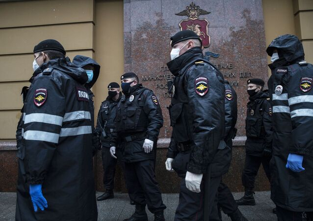 Russian police officers wearing protective face masks stand guard at a venue for pickets in support of journalist Ilya Azar, following a court's decision to jail him for his one-person protest during the coronavirus disease (COVID-19) lockdown, in Moscow, Russia May 29, 2020.