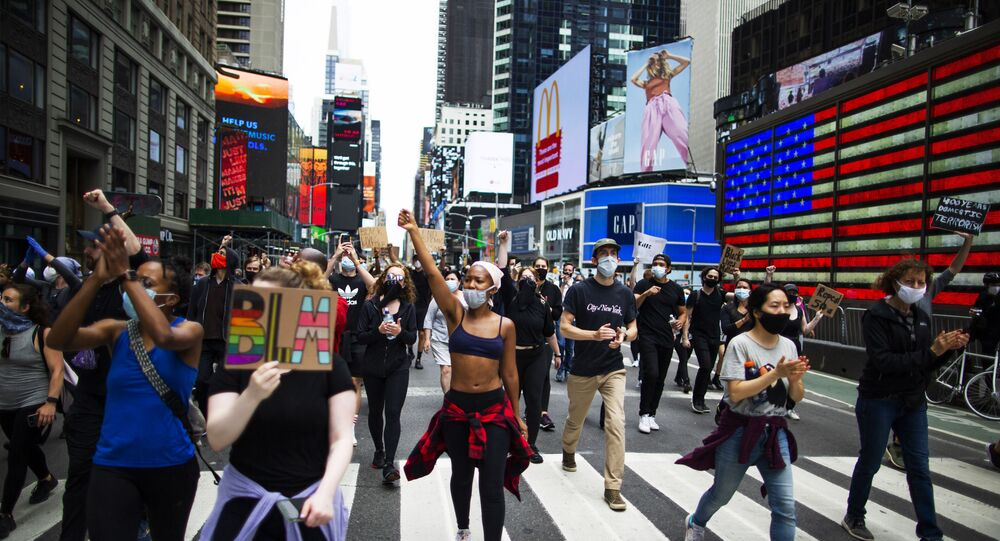 Protesters chant during a solidarity march for George Floyd down Times Square, Tuesday, June 2, 2020, in the Manhattan borough of New York