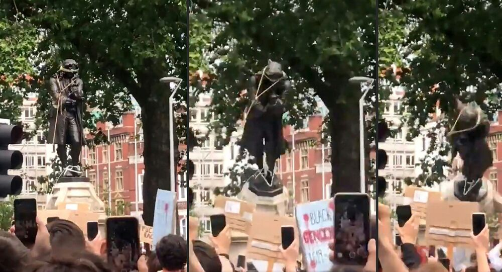 Protesters pulling down a statue of slave trader Edward Colston in Bristol during a Black Lives Matter protest on 7 June 2020.