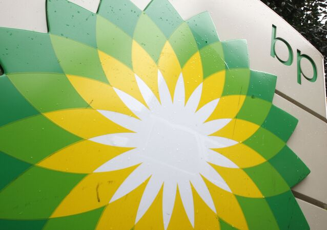 FILE - In this Oct. 25, 2007 file photo, the BP (British Petroleum) logo is seen at a gas station in Washington. BP will spend $7 billion to buy exploration rights to areas in the Gulf of Mexico, offshore Brazil and Canada owned by Devon Energy