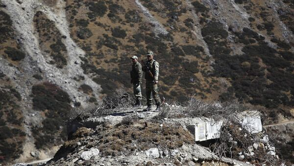 Indian army soldiers keep watch on a bunker at the Indo China border in Bumla at an altitude of 15,700 feet (4,700 meters) above sea level in Arunachal Pradesh, India, Sunday, Oct. 21, 2012 - Sputnik International