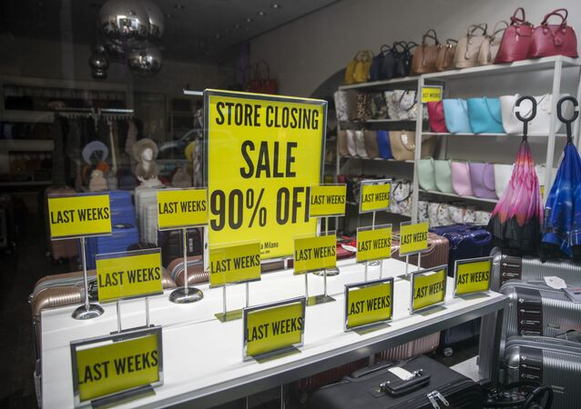 Store Closing sale signs are on display at a shop on Madison Avenue in New York