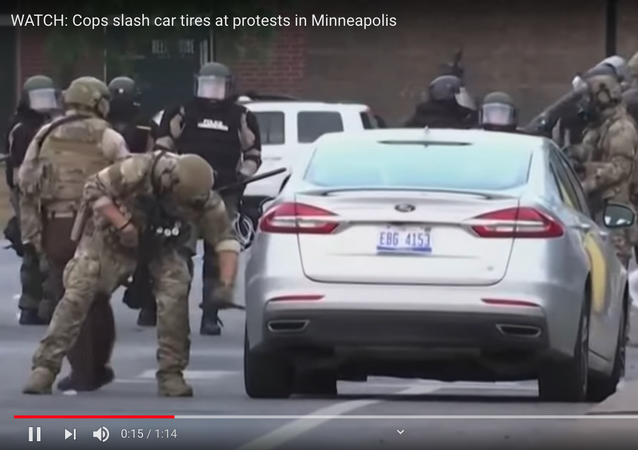WATCH: Cops slash car tires at protests in Minneapolis