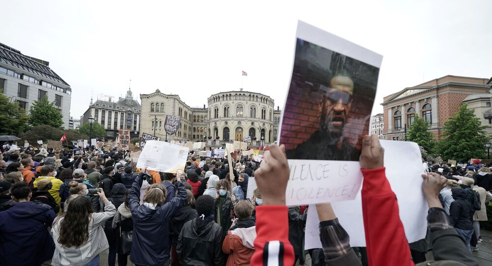 People take part in a demonstration called We can't breathe - justice for George Floyd outside the Parliament Building, in Oslo, Norway June 5, 2020.