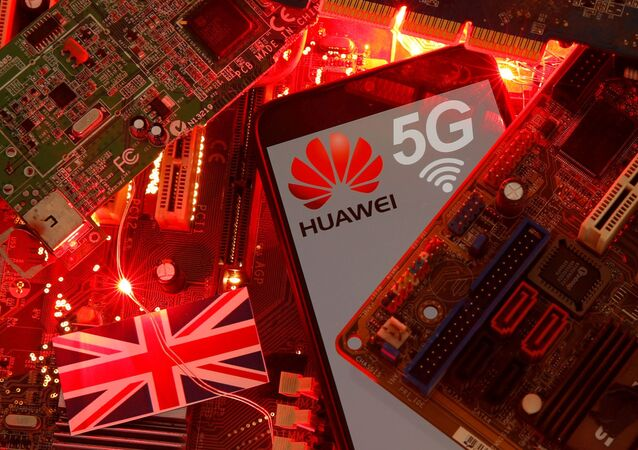 FILE PHOTO: The British flag and a smartphone with a Huawei and 5G network logo are seen on a PC motherboard in this illustration picture taken January 29, 2020. REUTERS/Dado Ruvic/File Photo