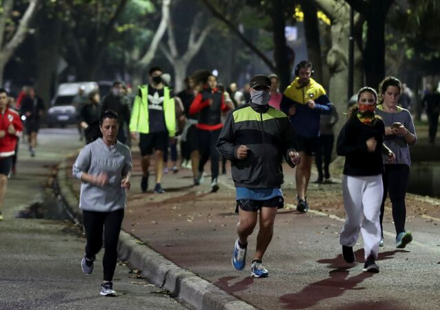 People jog at a park, as the city of Buenos Aires eases their lockdown restrictions, during the spread of the coronavirus disease (COVID-19), in Buenos Aires, Argentina June 8, 2020