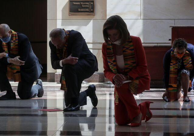 U.S. House Speaker Nancy Pelosi (D-CA) and Senate Minority Leader Chuck Schumer (D-NY) kneel with Congressional Democrats during a moment of silence to honor George Floyd, Breonna Taylor, Ahmaud Arbery and others inside Emancipation Hall after weeks of protests against racial inequality in the aftermath in Minneapolis police custody of Floyd, at the U.S. Capitol in Washington, U.S., June 8, 2020