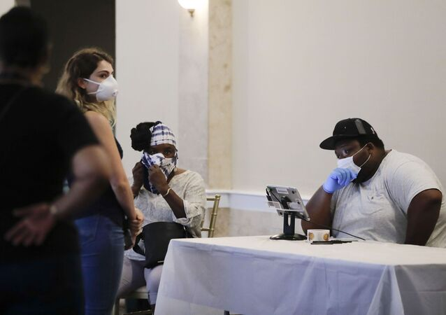 Voters wait near a polling place attendant in the Georgia's primary election at Park Tavern in Atlanta