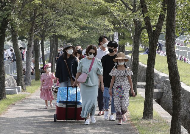 People wearing face masks to help protect against the spread of the new coronavirus visit to pay their respects on Memorial Day at the national cemetery in Seoul, South Korea, Saturday, June 6, 2020.