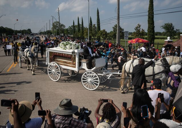 The horse-drawn carriage coffin of George Floyd, whose death in Minneapolis police custody has sparked nationwide protests against racial inequality, enters the Houston Memorial Gardens cemetery for his final resting place in Pearland, Texas, U.S., June 9, 2020