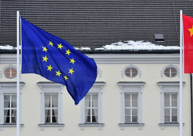 A Chinese (R) and EU flag flutters in front of the presidential palace Schloss Bellevue in Berlin
