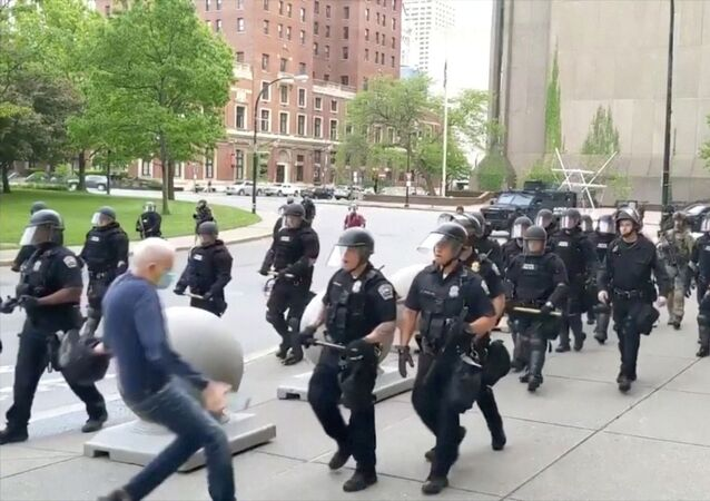 An elderly man falls after appearing to be shoved by riot police during a protest against the death in Minneapolis police custody of George Floyd, in Buffalo, New York, U.S. June 4, 2020 in this still image taken from video
