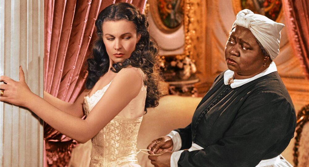In this image released by Turner Classic Movies, Vivien Leigh appears in character as Scarlett O'Hara, left, and Hattie McDaniel as Mammy, in the film, Gone with the Wind.  75 years after the premiere of the movie, Gone with the Wind, research is shedding light on the racial tensions that existed at the time between the producer and City of Atlanta officials. Emory University film studies professor, Matthew Bernstein, has conducted extensive research into the archives of the film's producer, David O. Selznick. His findings illustrate some of Selznick's concerns with the city's treatment of the film's black stars at the Dec. 15, 1939 premiere