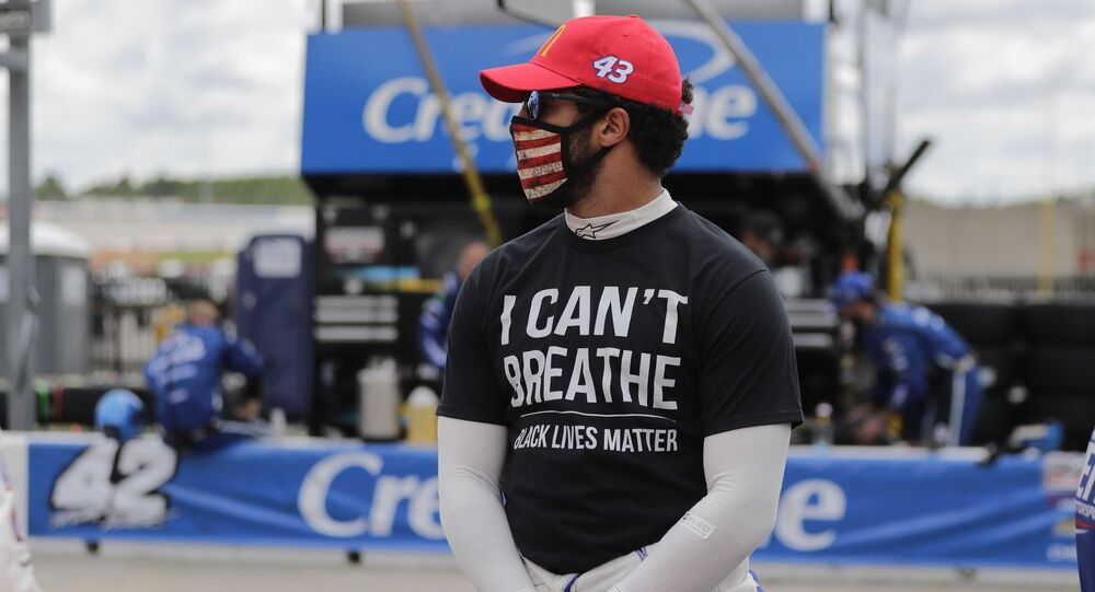 Bubba Wallace (43) wears a I Can't Breath, Black Lives Matter shirt before a NASCAR Cup Series auto race at Atlanta Motor Speedway, Sunday, June 7, 2020, in Hampton, Ga. (AP Photo/Brynn Anderson)
