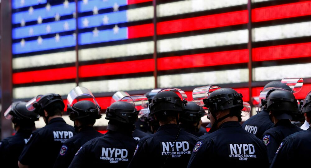 New York Police Department (NYPD) officers are pictured as protesters rally against the death in Minneapolis police custody of George Floyd, in Times Square in the Manhattan borough of New York City, U.S., June 1, 2020.