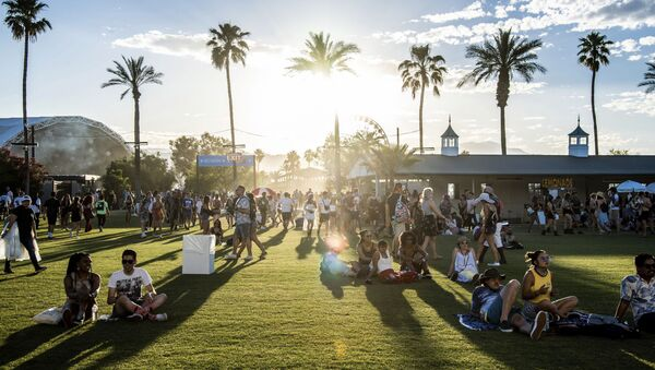 Festival goers attend the Coachella Music & Arts Festival at the Empire Polo Club on Friday, April 19, 2019, in Indio, Calif. - Sputnik International