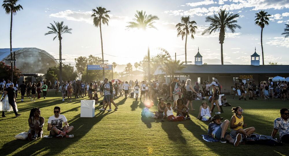 Festival goers attend the Coachella Music & Arts Festival at the Empire Polo Club on Friday, April 19, 2019, in Indio, Calif.