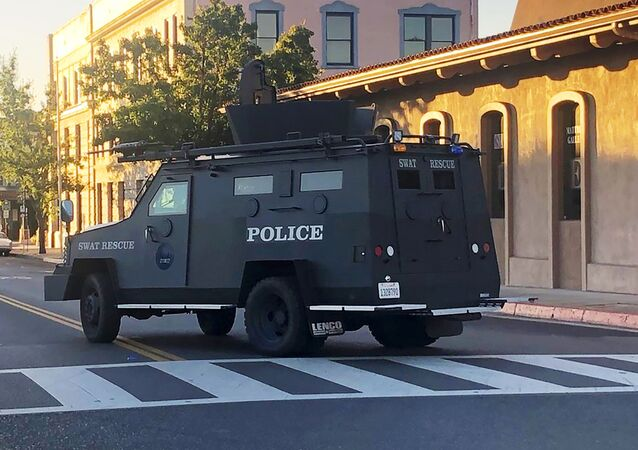 In this image taken from video and provided by KSBY-TV, an armored vehicle patrols the streets of Paso Robles in California's Central Coast region after a sheriff's deputy was wounded after someone opened fire on a police station early Wednesday, June 10, 2020.