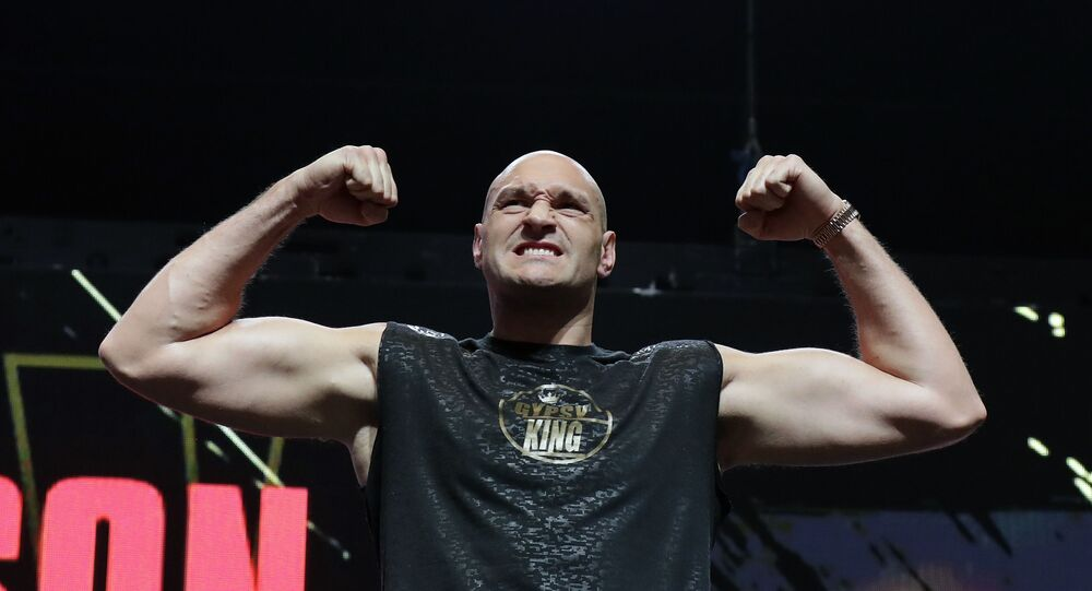 Tyson Fury stands on the scale during a weigh-in for his WBC heavyweight championship fight with Deontay Wilder in February 2020.