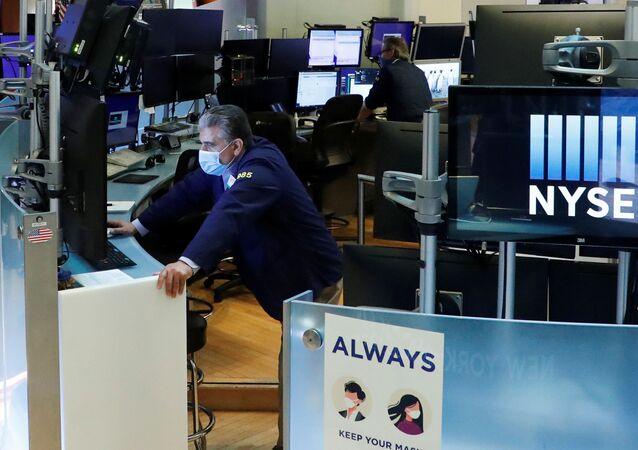Traders wear masks as they work on the floor of the New York Stock Exchange as the outbreak of the coronavirus disease (COVID-19) continues in the Manhattan borough of New York, U.S., May 27, 2020.