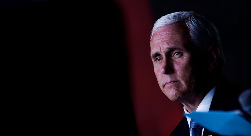 U.S. Vice President Mike Pence looks on during an event with community and faith leaders at Hope Christian Church in Beltsville, Maryland, U.S., June 5, 2020