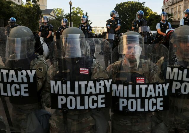 FILE PHOTO: DC National Guard Military Police officers and law enforcement officers stand guard during a protests against the death in Minneapolis custody of George Floyd, near the White House in Washington, D.C., U.S., June 1, 2020. REUTERS/Jonathan Ernst/File Photo