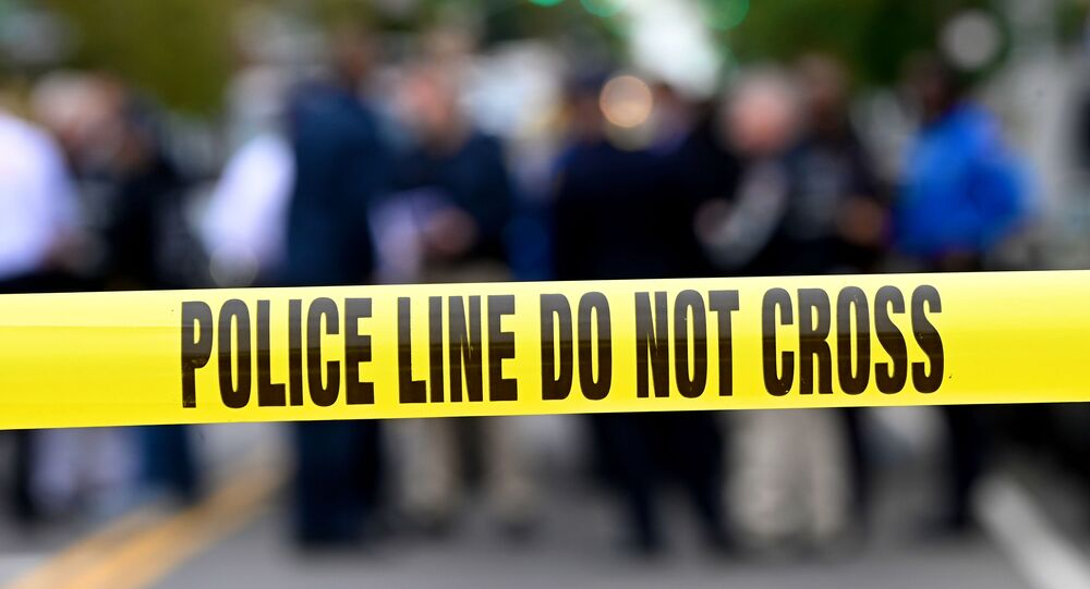 In this file photo Police tape secures a crime scene outside a club after a shooting in Brooklyn on October 12, 2019.