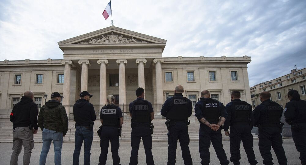 French police officers stand back in front of Marseille's High Court as they threw their handcuffs on the ground during a gathering in Marseille, southern France on June 11, 2020, to protest against the French Interior Minister's latests announcements following demonstrations against police violence.
