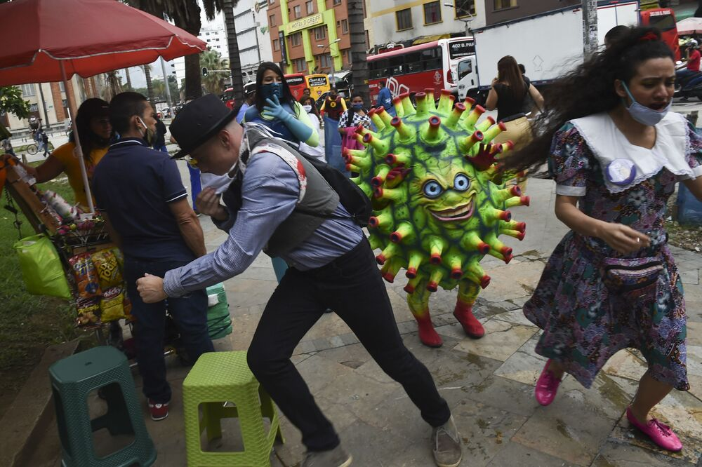 Artist performs at the Botero square, as part of an awareness campaign to stop the spread of the COVID-19 coronavirus, in Medellin, Colombia, on June 10, 2020.