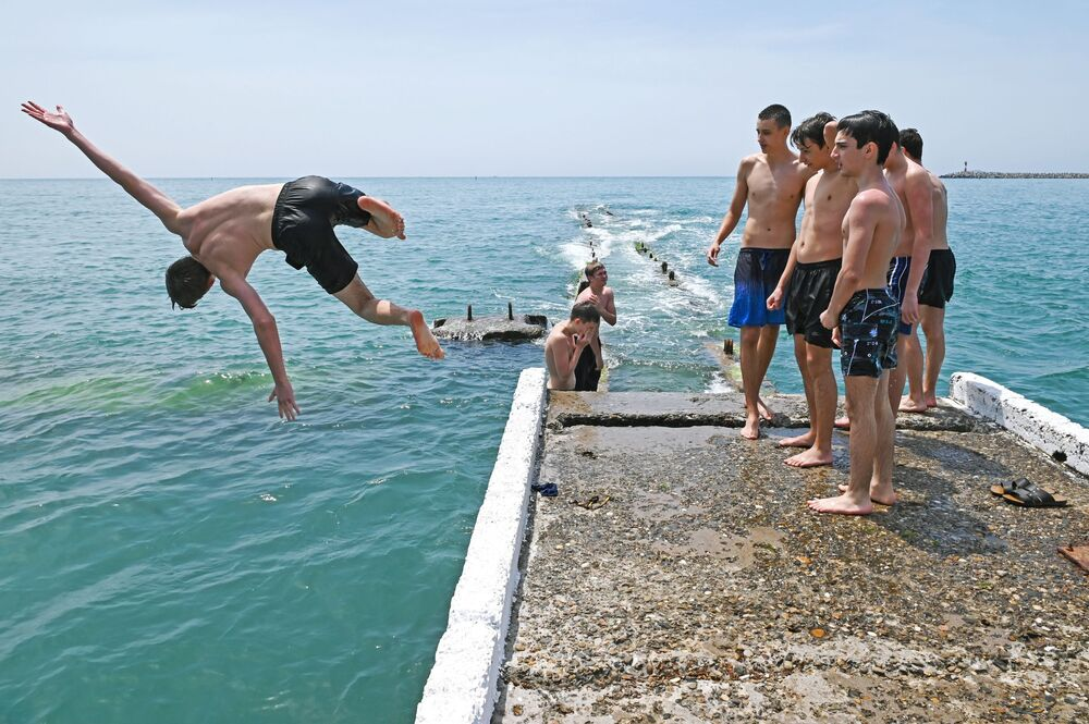 Swimmers in Russia's resort town of Sochi on 9 June 2020
