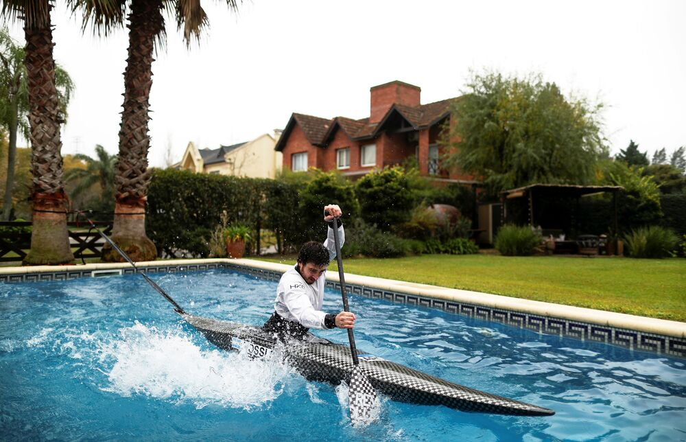Argentine canoeist Sebastian Rossi trains in his girlfriend's pool, due to the coronavirus disease (COVID-19) outbreak, as he prepares for the postponed Tokyo 2020 Olympic Games, in Buenos Aires, Argentina June 8, 2020.