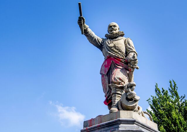 The statue of Dutch lieutenant admiral and commander of the West India Company Piet Hein in Rotterdam-Delfshaven is daubed and smeared with red paint (unseen)on June 12, 2020. - Dutch protesters on June 12, 2020, damaged the statues of a colonialist naval commander linked to the slave trade and of a murdered far-right politician, in the latest incidents targeting statues in Europe and the United States. The statue of Piet Hein -- a 17th-century admiral linked to the Dutch West India Trading Company who is regarded as one of the Netherlands' greatest naval heroes -- was sprayed with the words killer and thief overnight in Rotterdam.