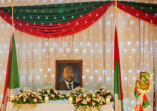 The portrait of Burundi's President Pierre Nkurunziza who died at the age of 55 is set on an altar during the memorial service by Burundi's ruling party, the National Council for the Defense of Democracy - Forces for the Defense of Democracy (CNDD-FDD), at CNDD-FDD headquarters in Bujumbura on June 11, 2020.