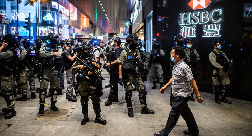 Police secure an area in the Central district of Hong Kong on 9 June 2020, as the city marks the one-year anniversary since pro-democracy protests erupted following opposition to a bill allowing extraditions to mainland China.