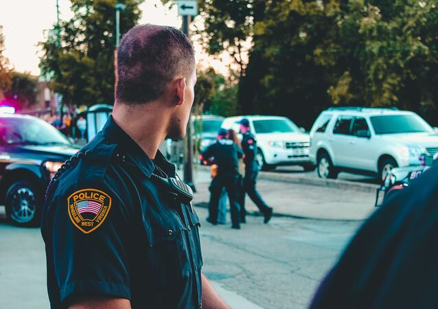 Man wearing black officer uniform - Photo by Rosemary Ketchum from Pexels