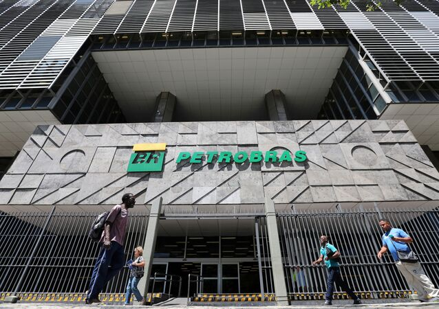 People walk in front of the headquarters of Petroleo Brasileiro S.A. (Petrobas) in Rio de Janeiro, Brazil March 9, 2020.