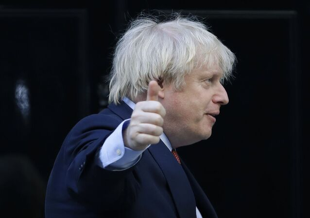 Britain's Prime Minister Boris Johnson gestures after applauding on the doorstep of 10 Downing Street, during the weekly Clap for our Carers, in London, Thursday, 28 May 2020.