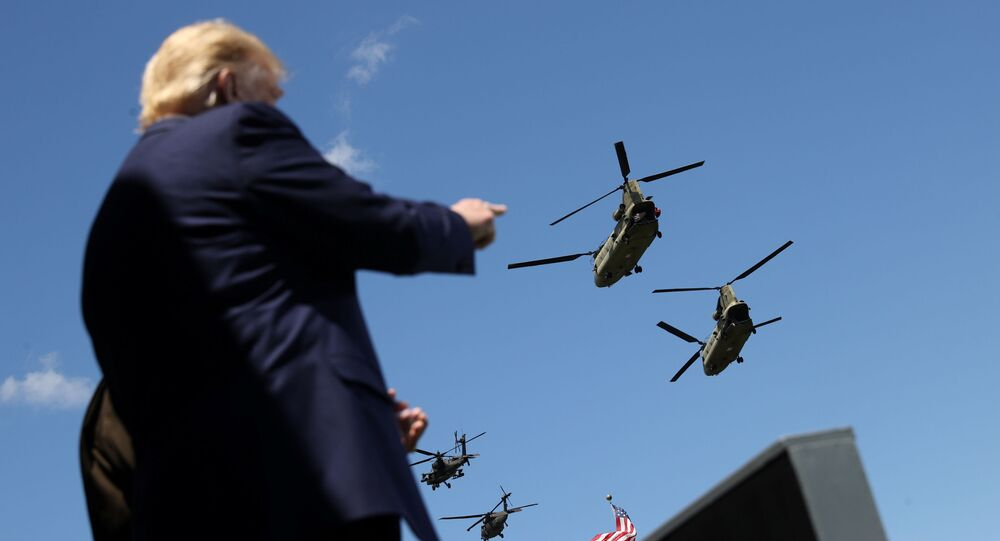 U.S. President Donald Trump points at West Point graduating cadets as U.S. Army helicopters fly overhead at the culmination of the 2020 United States Military Academy Graduation Ceremony at West Point, New York, U.S., June 13, 2020.