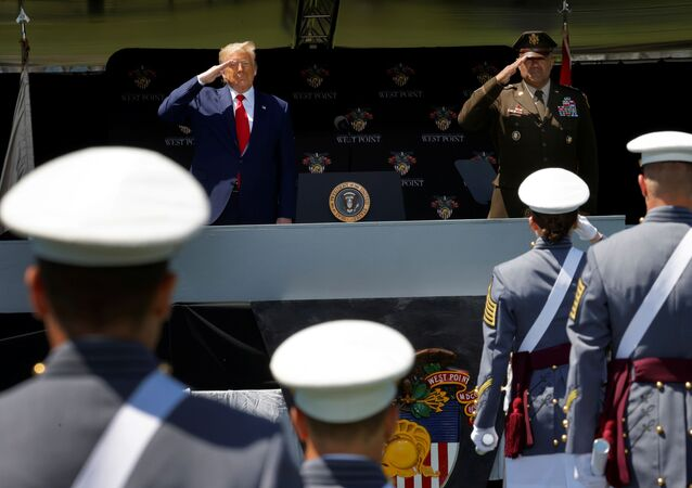 U.S. President Donald Trump salutes alongside U.S. Army Lieutenant General Darryl Williams, the Superintendent of the U.S. Military Academy at West Point, as he prepares to deliver the commencement address at the 2020 United States Military Academy Graduation Ceremony in West Point, New York, U.S., June 13, 2020.