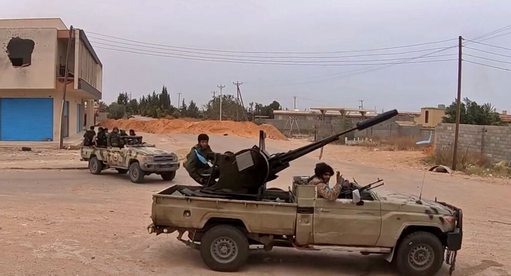 Fighters loyal to Haftar on a road south of the capital Tripoli