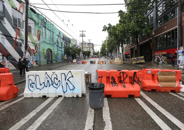 Barricades line a street near a closed Seattle police precinct Tuesday, June 9, 2020, in Seattle, following protests over the death of George Floyd, a black man who was in police custody in Minneapolis.