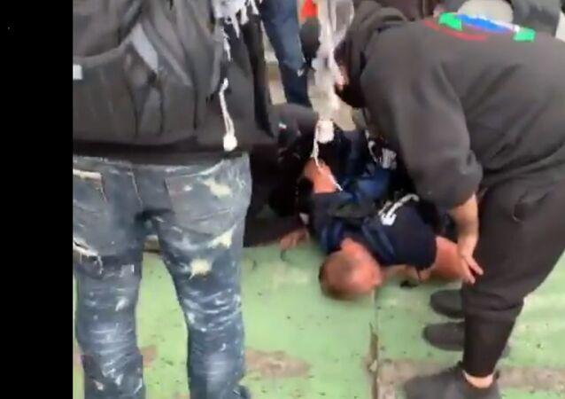 Protesters hold down a preacher in self-declared Autonomous Zone