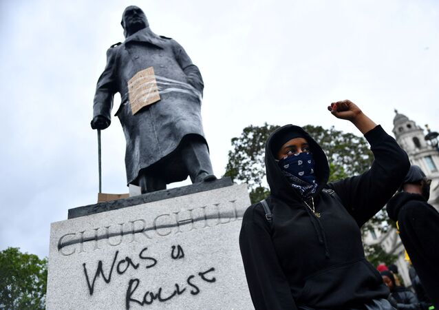 FILE PHOTO: A demonstrator reacts infront of graffiti on a statue of Winston Churchill in Parliament Square during a Black Lives Matter protest in London, following the death of George Floyd who died in police custody in Minneapolis, London, Britain, June 7, 2020.