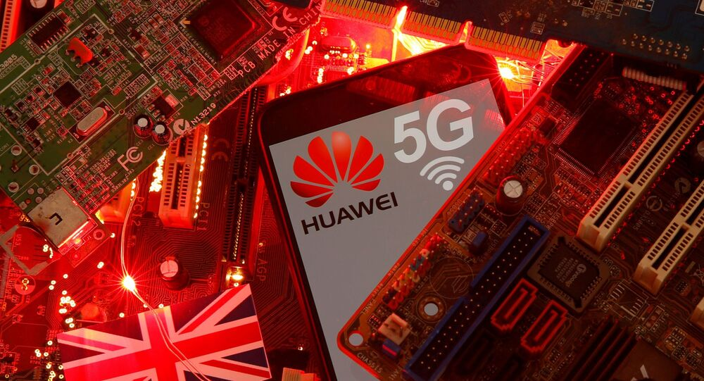 The British flag and a smartphone with a Huawei and 5G network logo are seen on a PC motherboard in this illustration picture taken January 29, 2020.