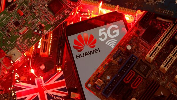 The British flag and a smartphone with a Huawei and 5G network logo are seen on a PC motherboard in this illustration picture taken January 29, 2020. - Sputnik International