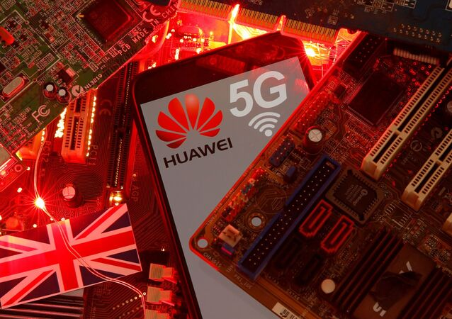 The British flag and a smartphone with a Huawei and 5G network logo are seen on a PC motherboard in this illustration picture taken 29 January 2020.